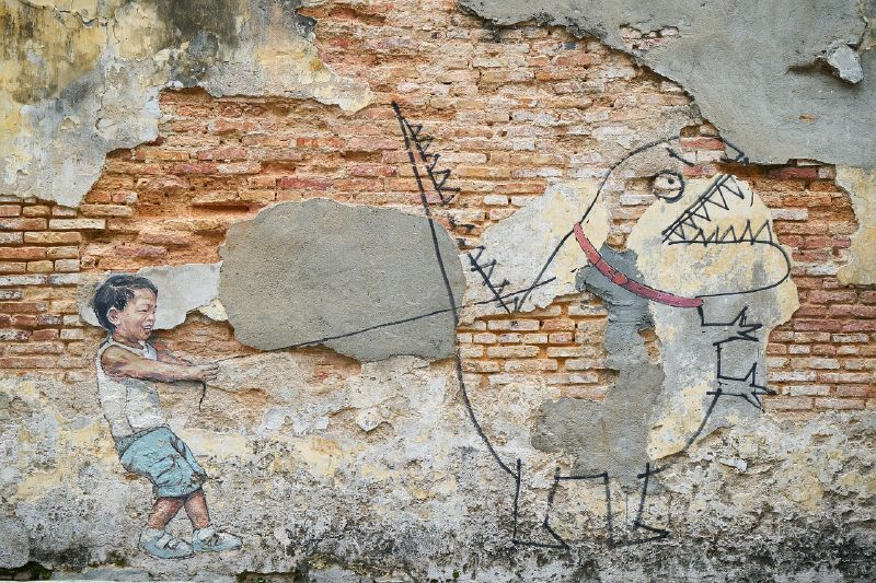 """Little Boy walking his Pet Dinosaur"" (George Town, Penang, Malaysia)"
